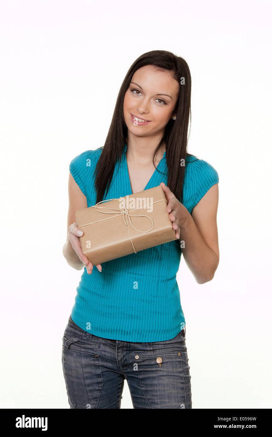 Woman with package of a dispatch service, Frau mit Paket eines Versanddienstes Stock Photo