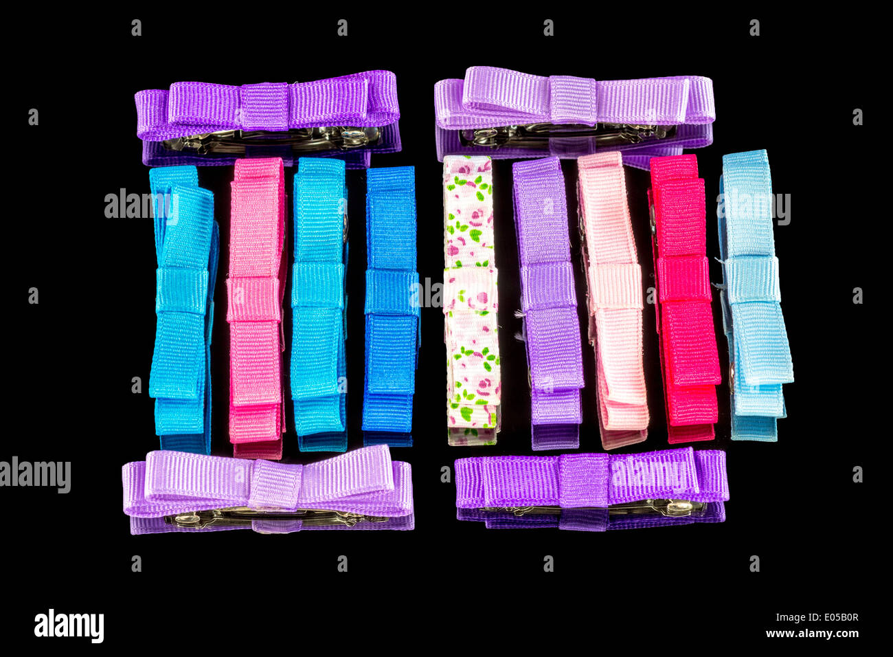 Collection of different colored hair bows - Stock Image
