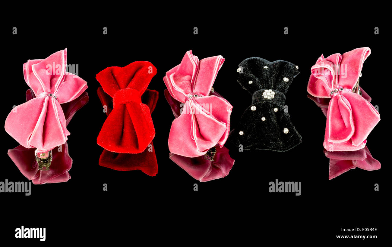 Fancy hair bows in a row - Stock Image