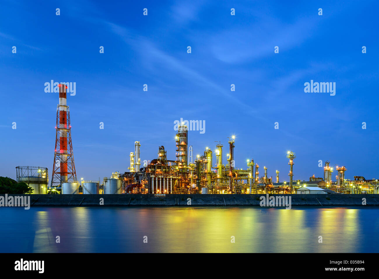 Oil refineries line a river in Yokkaichi, Japan. The city has been a center for the chemical industry since the - Stock Image