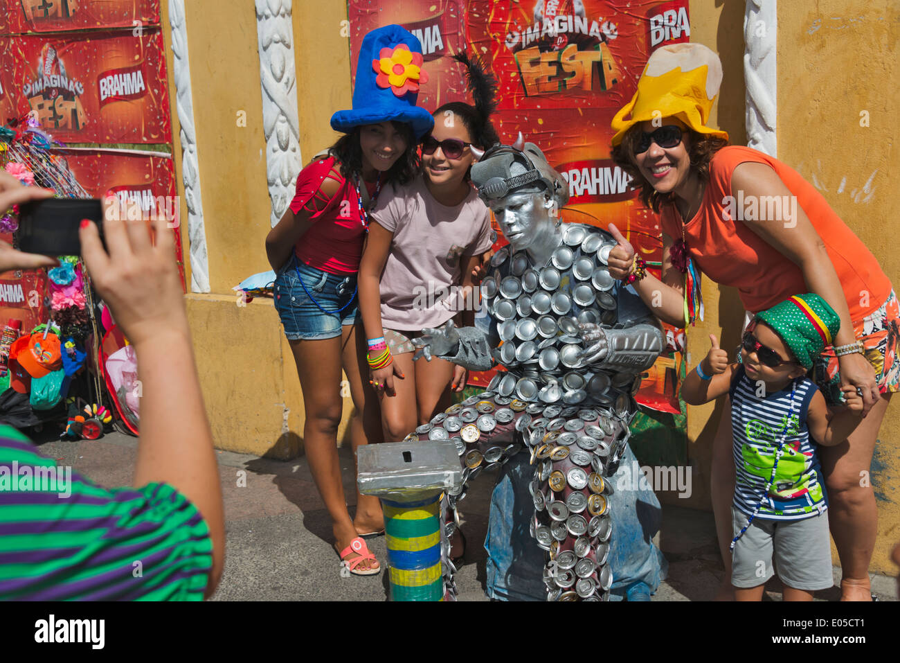 Tourists taking picture with mime in Pelourinho District, Salvador (UNESCO World Heritage site), Bahia State, Brazil - Stock Image