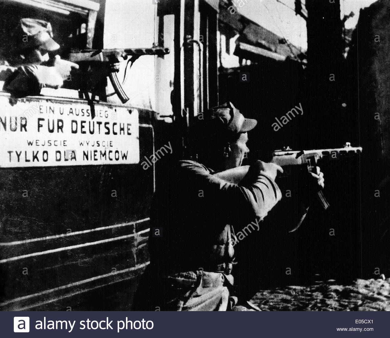 Street fight in Warsaw, Poland in the tramway depot during Second World War with the racist caption 'only for Germans' seen on the tram - Stock Image