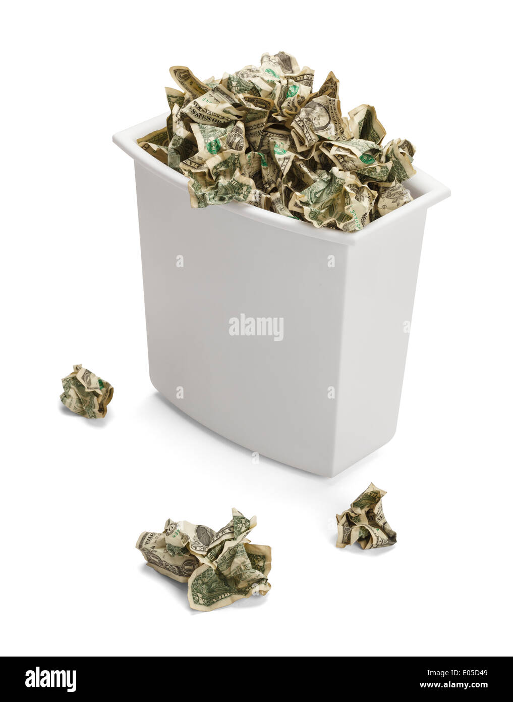 Trash Can full of Crumpled Dollars Over Flowing of Frustration. Isolated on a white background. - Stock Image