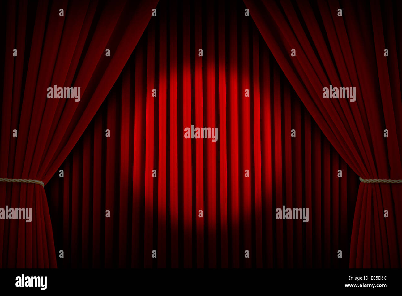 Red Velvet Stage Curtains with Center Spotlight. - Stock Image