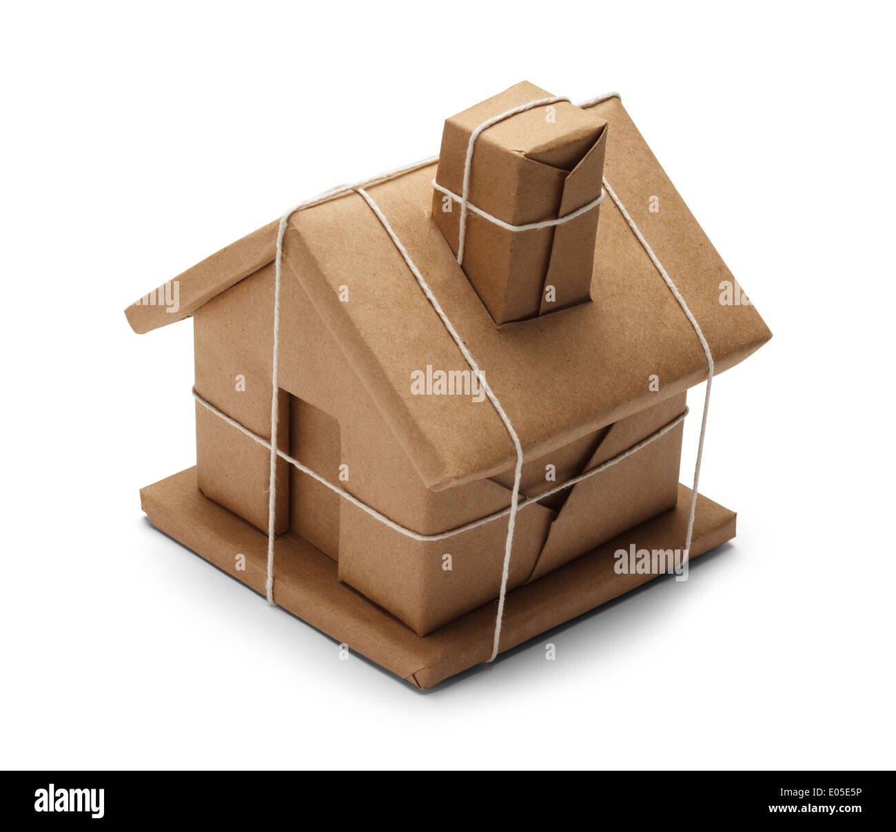 House Wrapped up In Brown Paper And String rope Isolated on White Background. - Stock Image