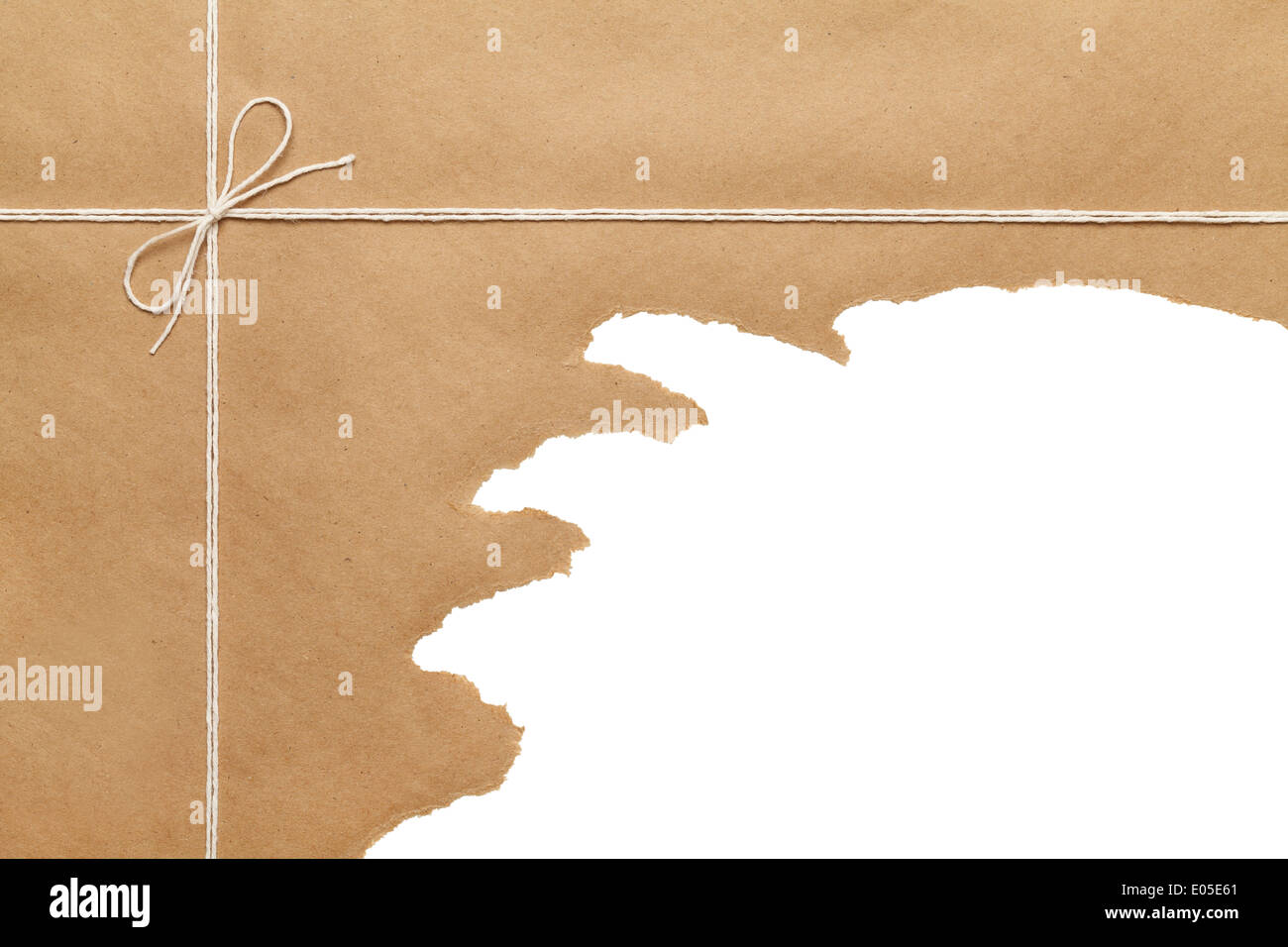 Brown Paper Package Tied with thin Rope string bow Torn Open on White Background Copy space. - Stock Image