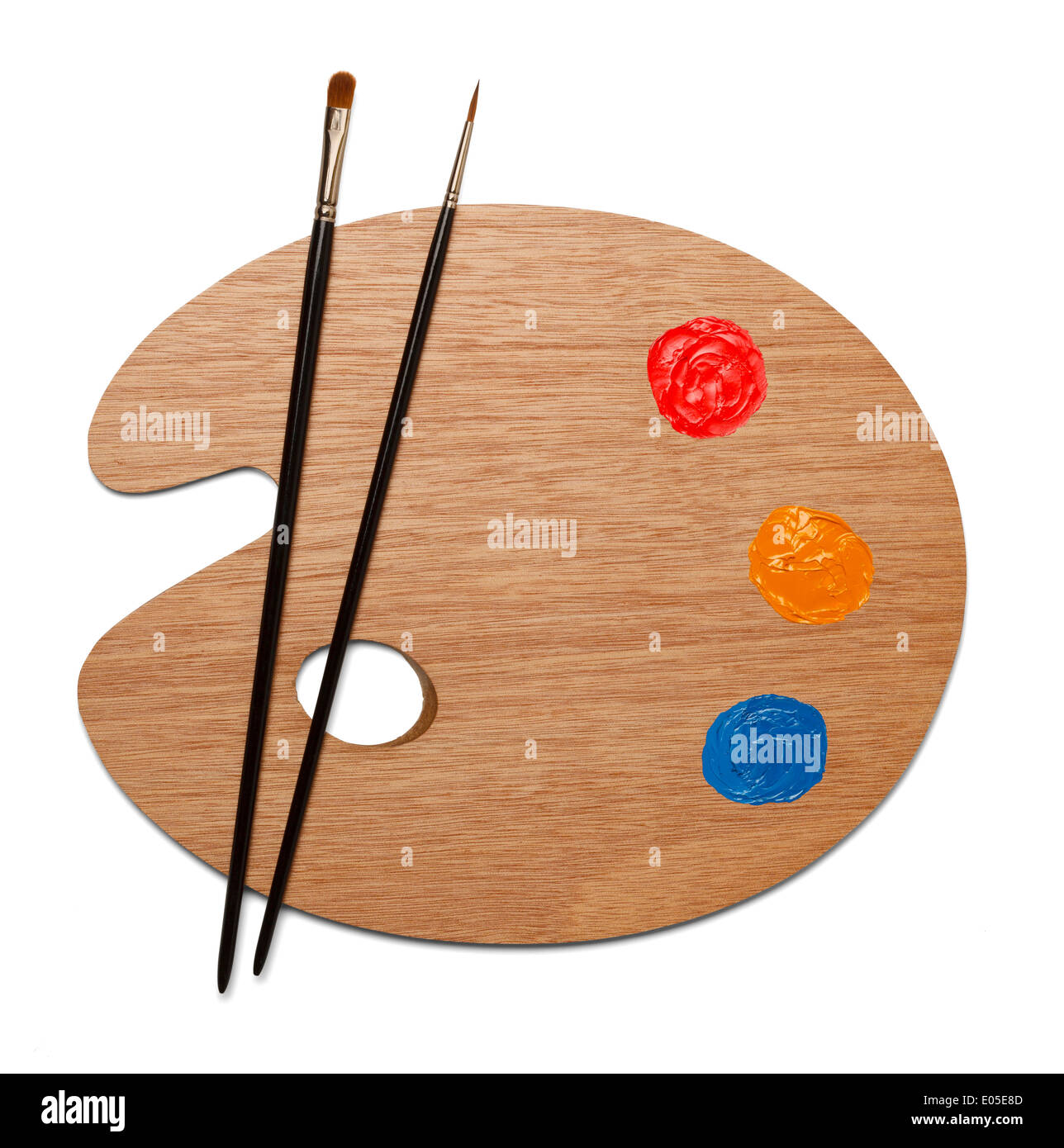 Artist wooden painting palette with two sable brushes with red, yellow and blue paint on white background. - Stock Image