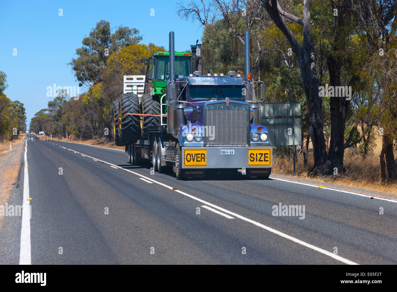 Kenworth Truck transporting a large tractor near Collie, Western Australia - Stock Image