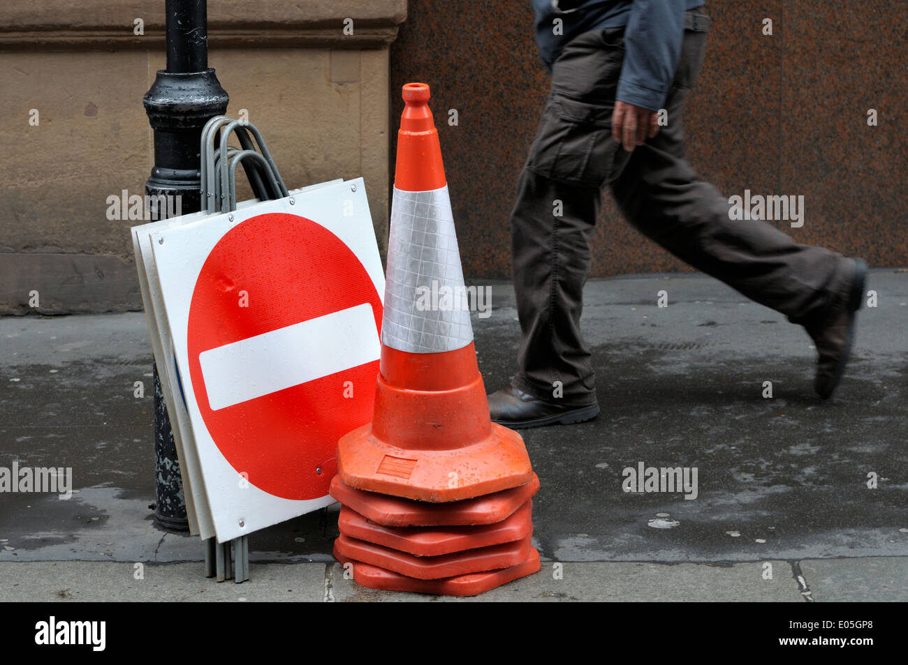London, England, UK. Stacked traffic cones and No Entry signs by the street - Stock Image