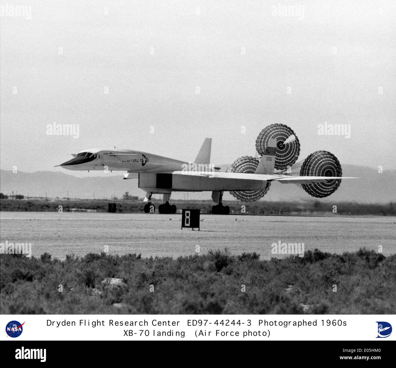 XB-70A landing with drag chutes deployed - Stock Image