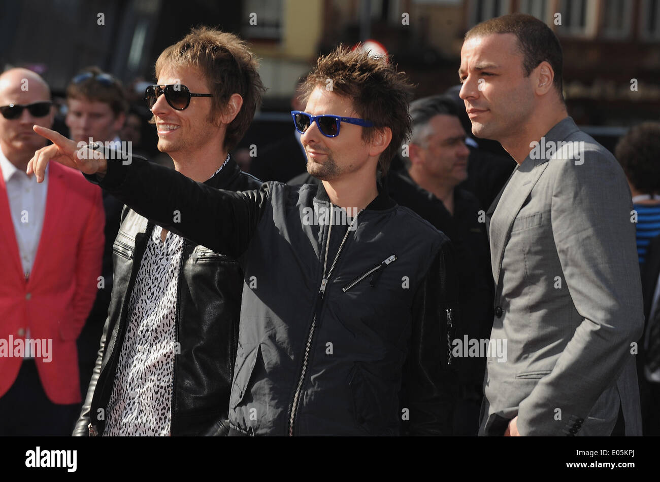 London uk uk 2nd june 2013 dominic howard matt bellamy and 2nd june 2013 dominic howard matt bellamy and chris wolstenholme of muse arrive for the premiere of world war z at the empire cinema voltagebd Image collections