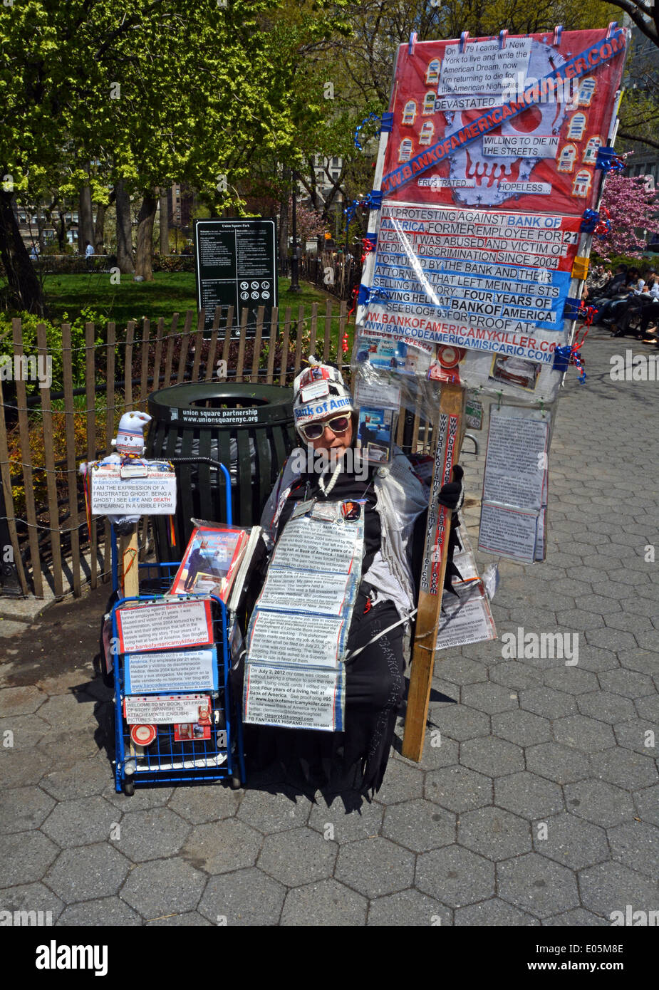A woman demonstrating against the Bank of America  at the May Day Rally at Union Square Park in Manhattan, New York City. - Stock Image