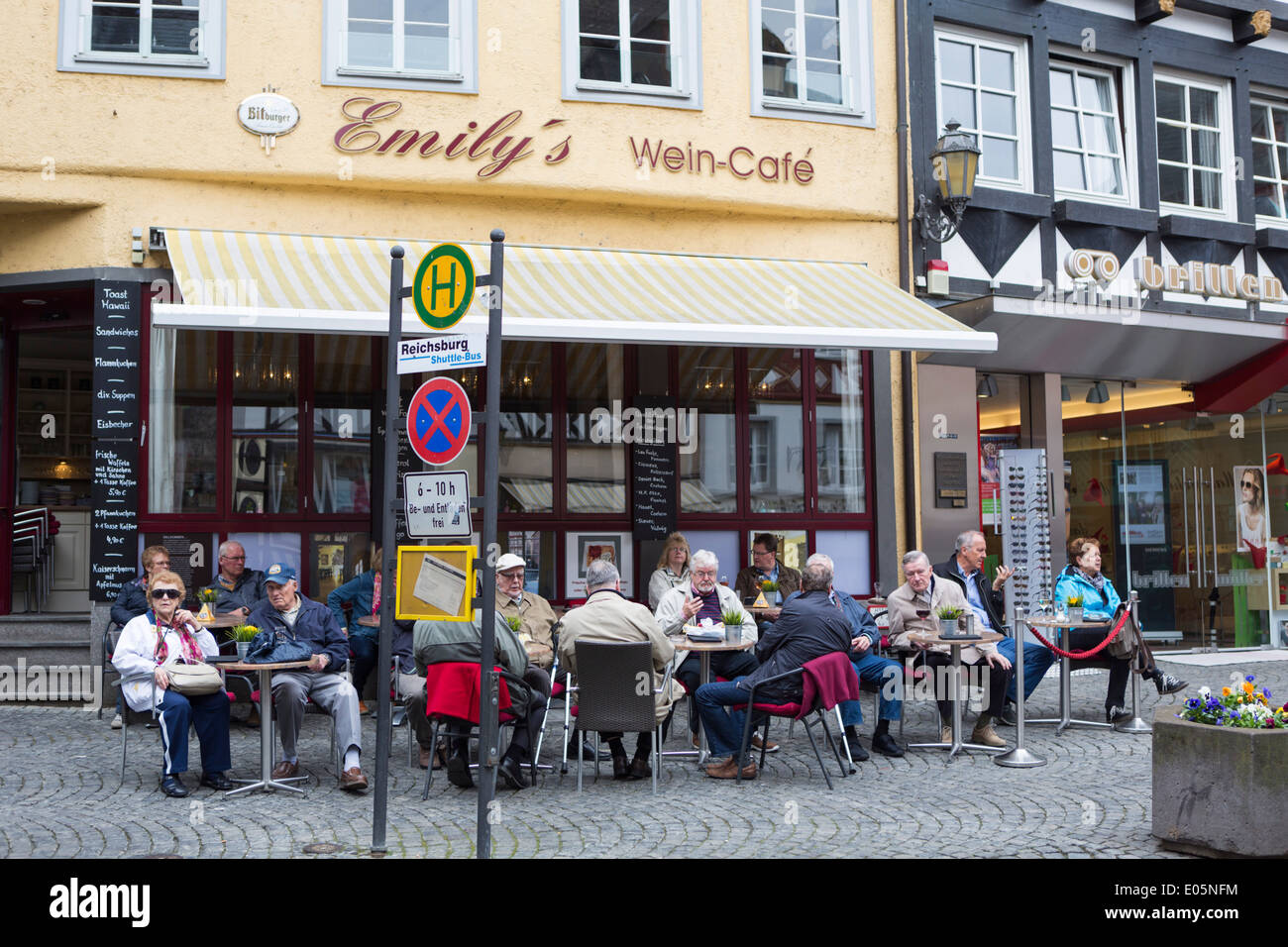 People having coffee in the center of Cochem - Stock Image