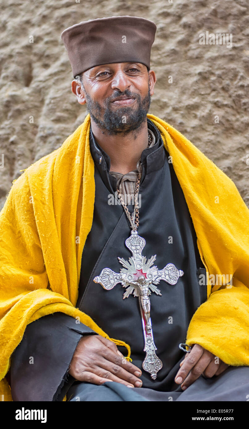 Priest in front of Church of Bete Medhane Alem in Lalibela, Ethiopia - Stock Image