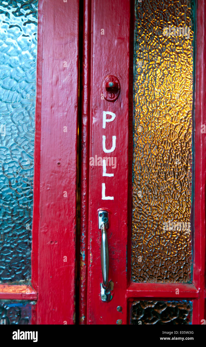 Pull Written In White Paint On Red Door Of A Bar Pub In Cork City