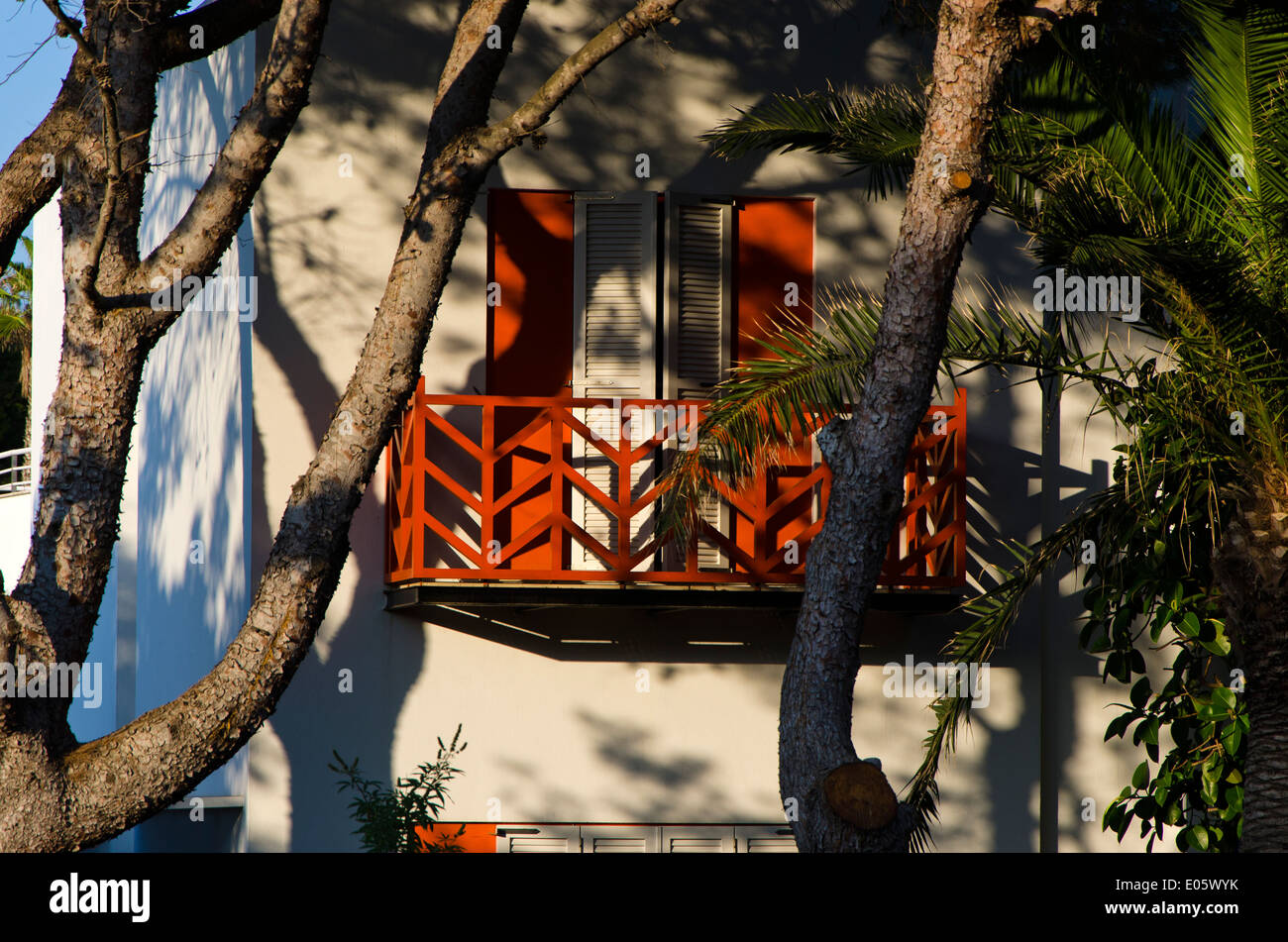Mediterranean balcony with shuttered windows. - Stock Image
