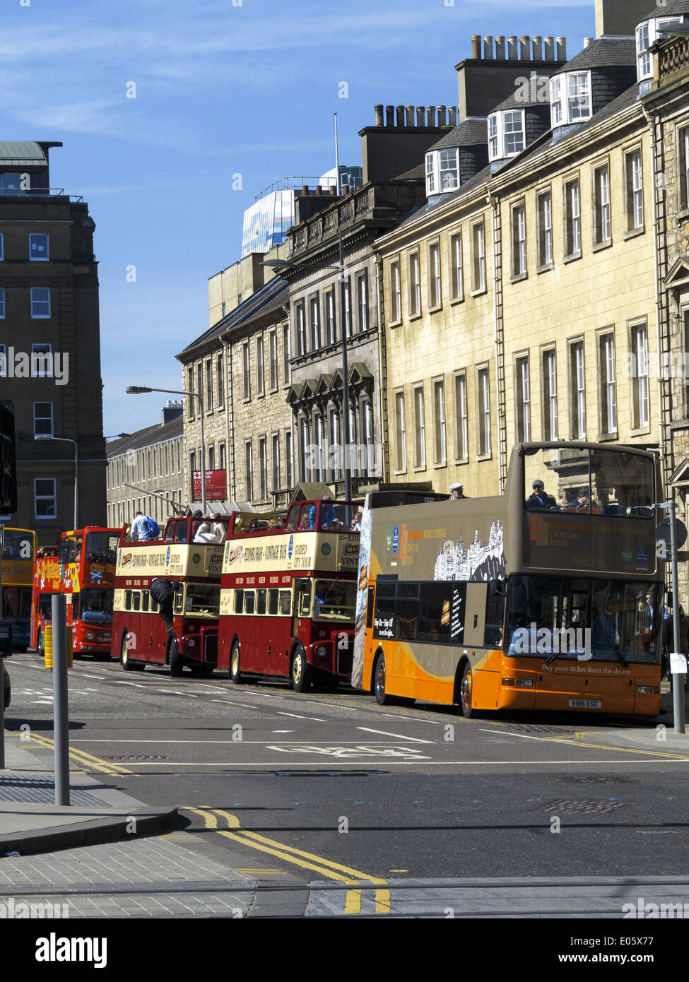 Open topped tourist buses at St Andrew Square Edinburgh Scotland - Stock Image