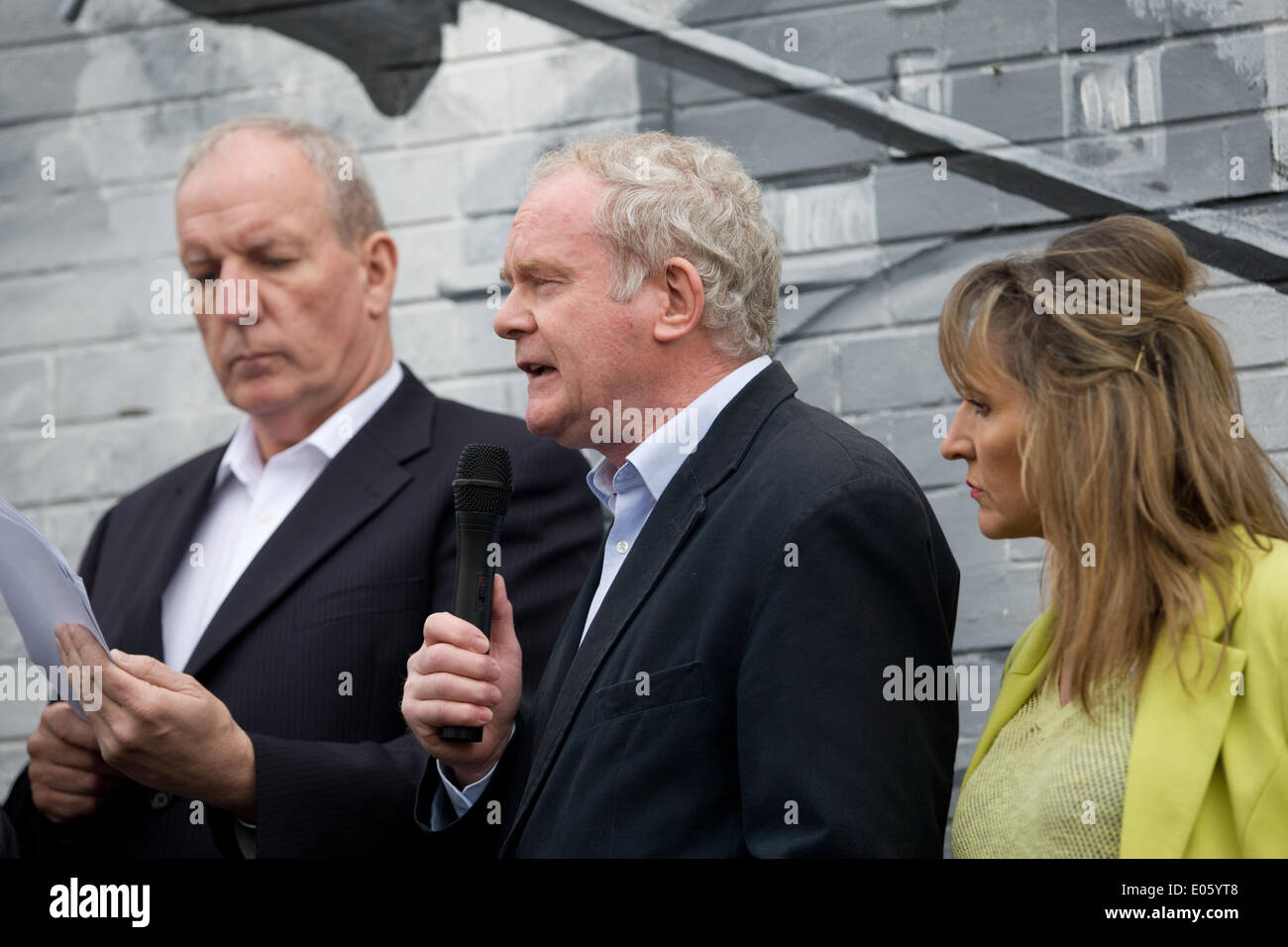 Divis Street, Belfast, Northern Ireland, UK. 3rd May 2014. Bobby Storey, Martin McGuinness and Martina Anderson at the new mural on Divis Street, Belfast, against the continuing detention of Mr Adams Credit:  Bonzo/Alamy Live News - Stock Image