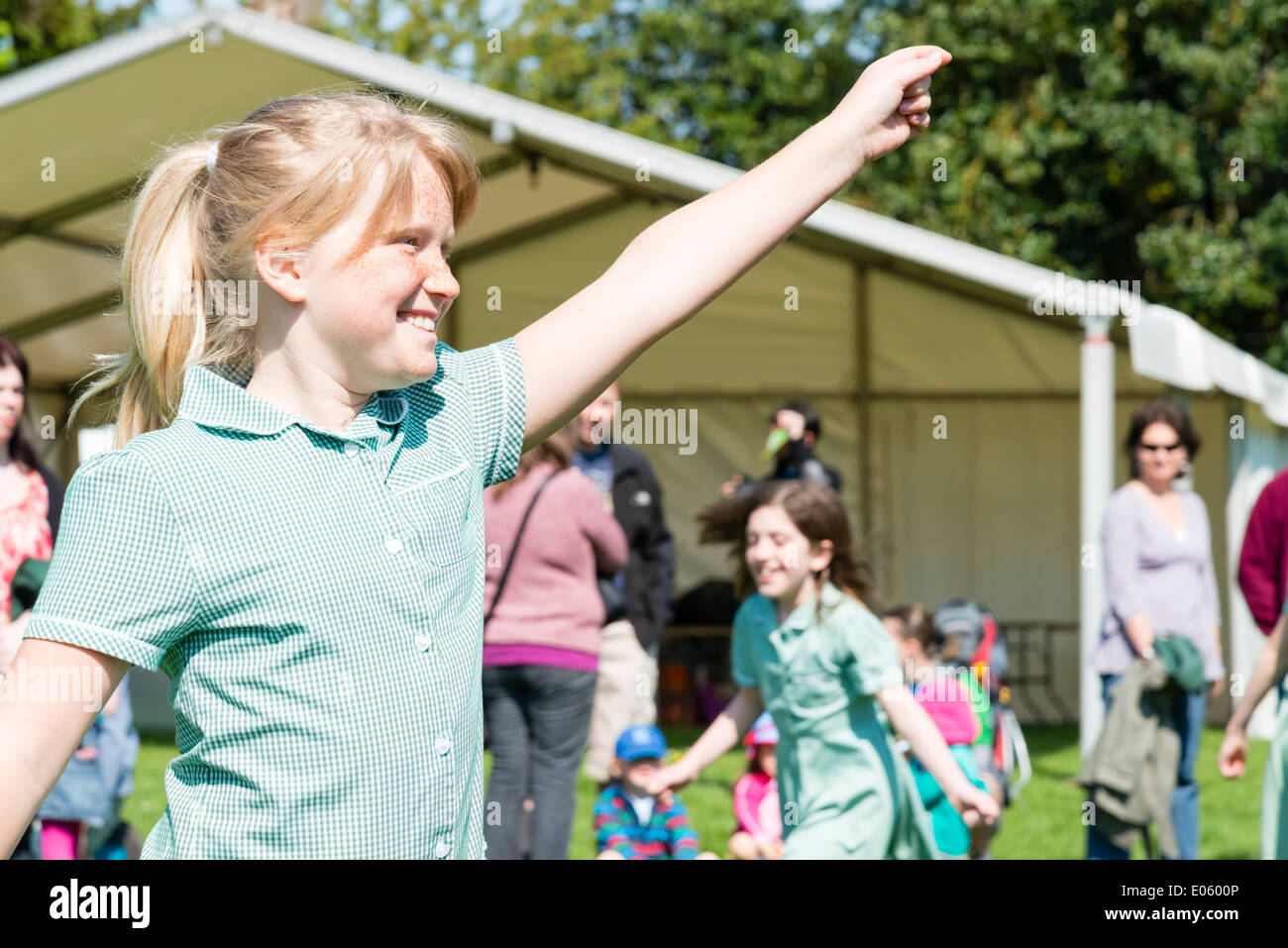 Primary school girls dancing at the Castle Green Festival, Hereford, UK. - Stock Image