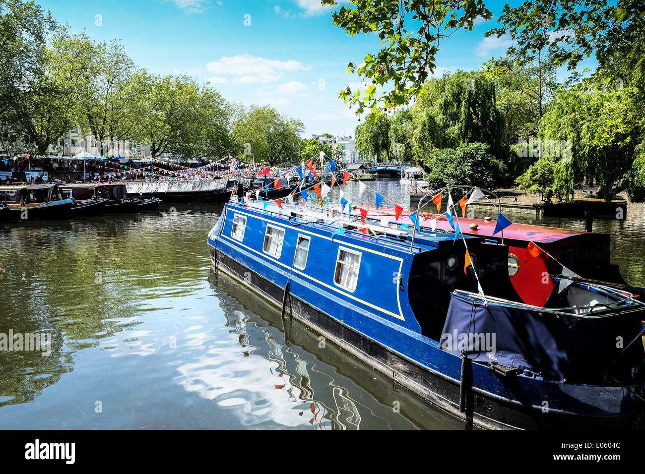 Little Venice, London, UK. 3rd May 2014. The annual Canalway Cavalcade celebration organised by the Inland Waterways Association, is taking place over the May Day holiday weekend at Little Venice, Paddington, London. Over 100 colourful canal boats are present at this traditional event.  Photographer:  Gordon Scammell/Alamy Live News - Stock Image