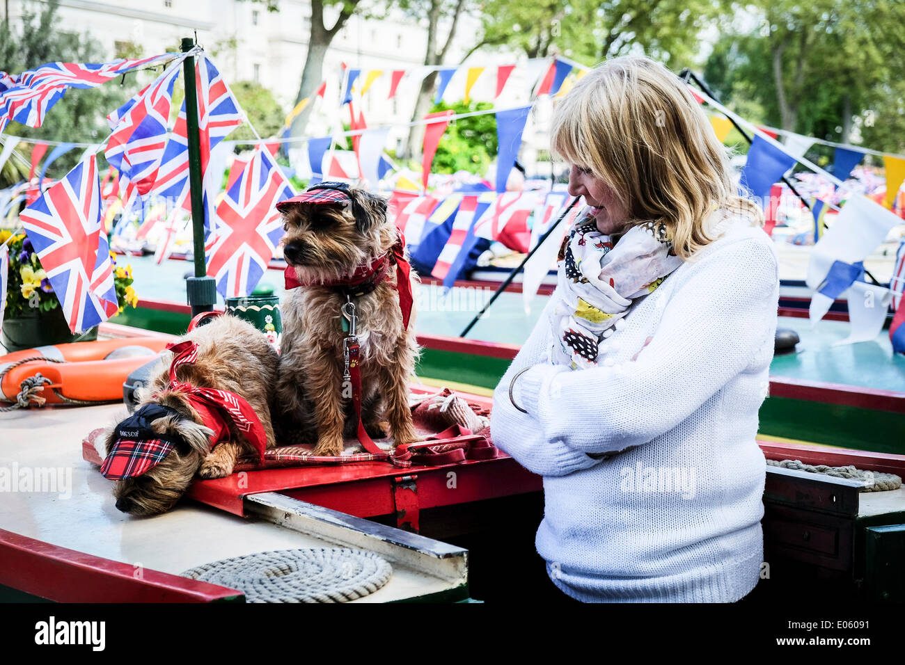 Little Venice, London, UK. 3rd May 2014. Two dogs, Pixie and Gyp dressed as traditIonal bargees with their owner Sandra at the annual Canalway Cavalcade.  The celebration is organised by the Inland Waterways Association and is taking place over the May Day holiday weekend at Little Venice, Paddington, London.  Photographer:  Gordon Scammell/Alamy Live News - Stock Image