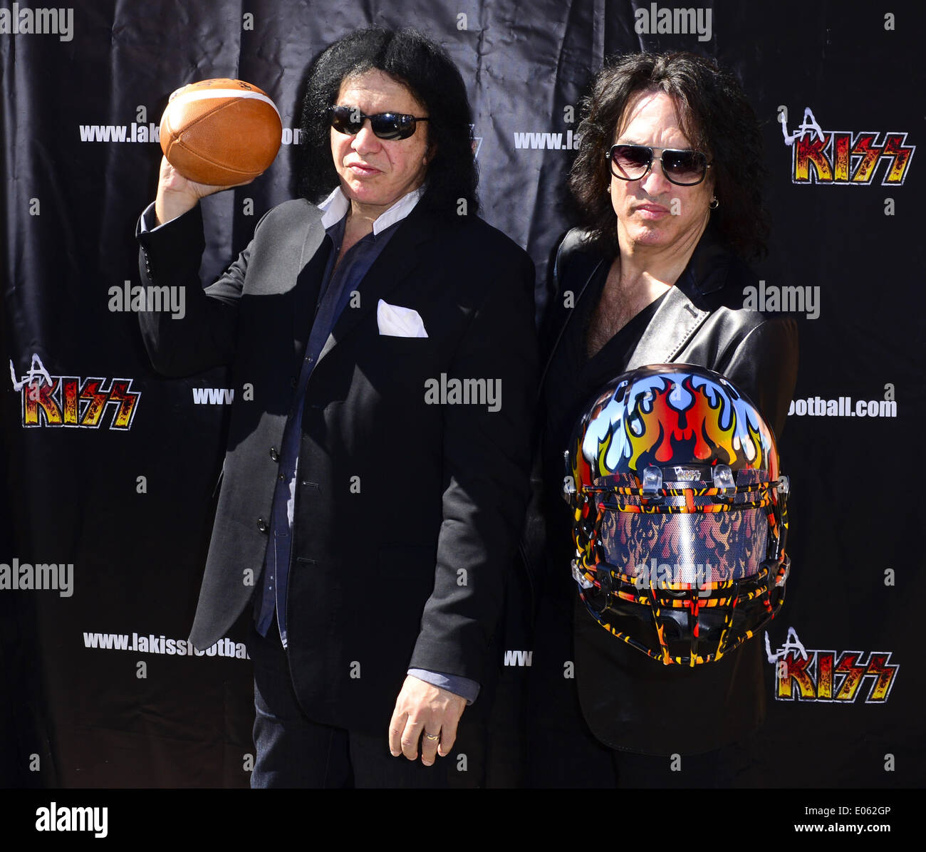 Anaheim, California, USA. 10th Mar, 2014. Kiss band members GENE SIMMONS and PAUL STANLEY pose with the newly unveiled LA Kiss Arena Football helmet on Monday morning at Honda Center. The newly formed LA Kiss, Arena Football's newest team, held their first media event at The Honda Center on Monday morning, March 10, 2014, in Anaheim. The LA Kiss, named after famed rock and roll band, Kiss, boasts two members of the band as owners, Gene Simmons and Paul Stanley. The co-owners announced a free Kiss concert for all season ticket holders as part of a $99 dollar package. (Credit Image: © David - Stock Image