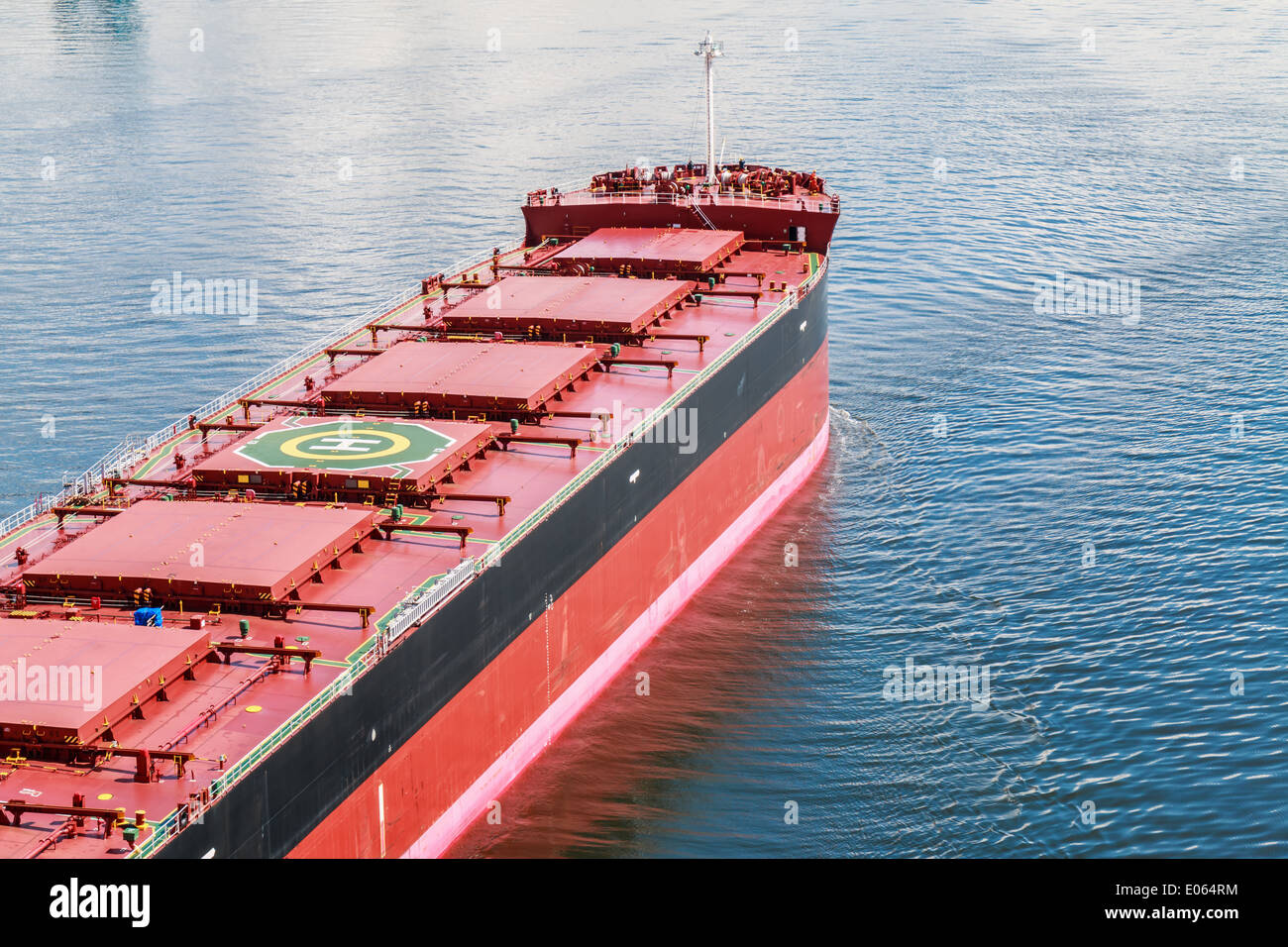 Large bulk carrier with Helicopter Pad on the deck. - Stock Image
