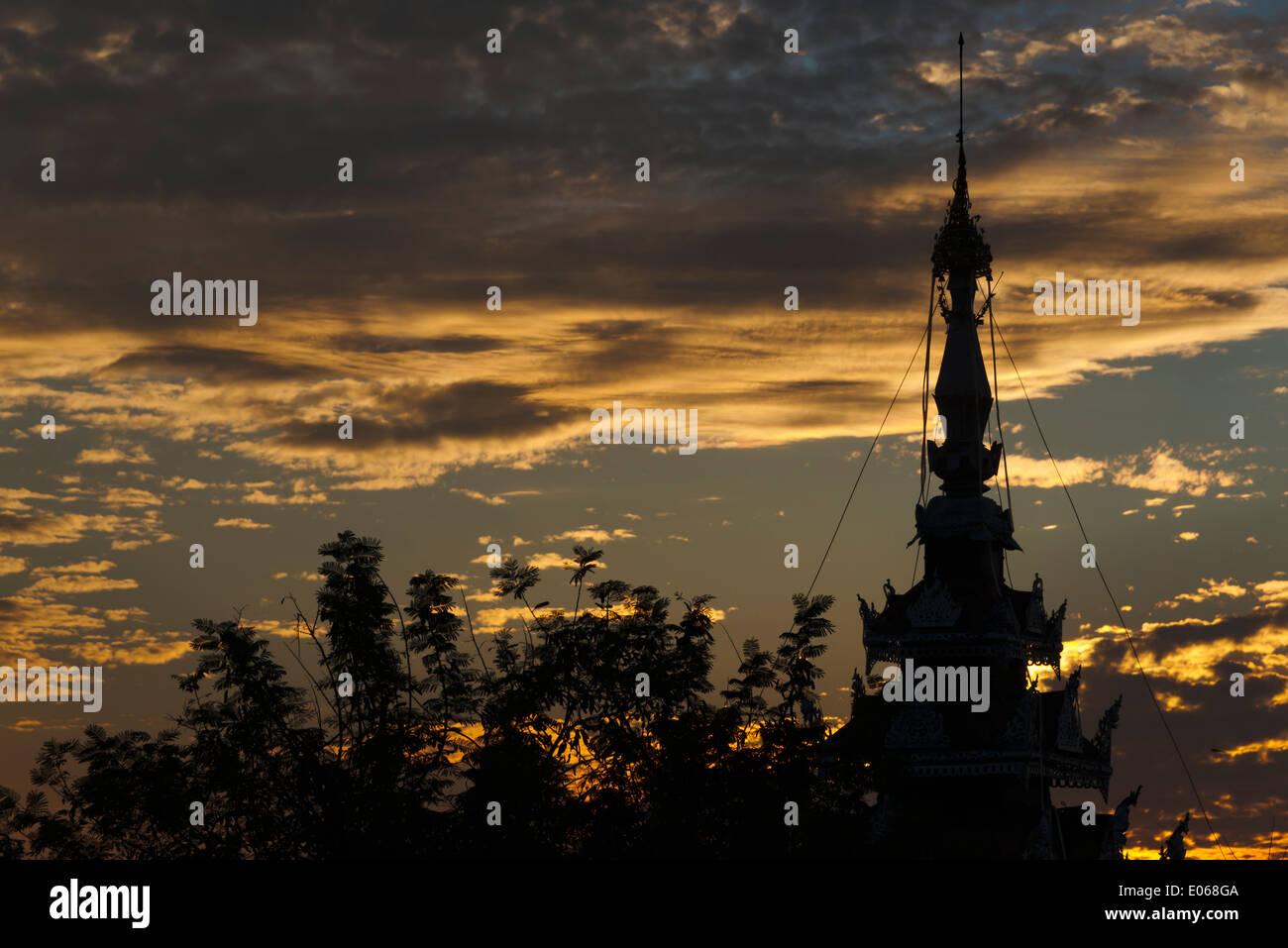 Sutaungpyei Pagoda on Mandalay Hill at sunset, Mandalay, Myanmar - Stock Image