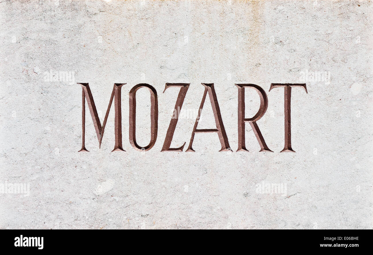 MOZART Letters - The name Mozart written in capital letters and carved in stone. - Stock Image