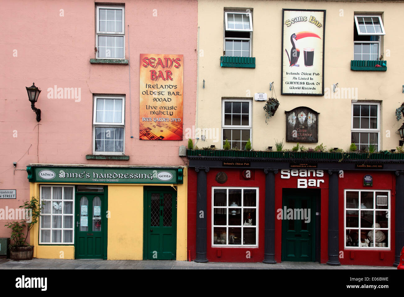 Athlone streetscape showing Seans Bar, the oldest pub in Ireland and Shines Hairdresser - Stock Image