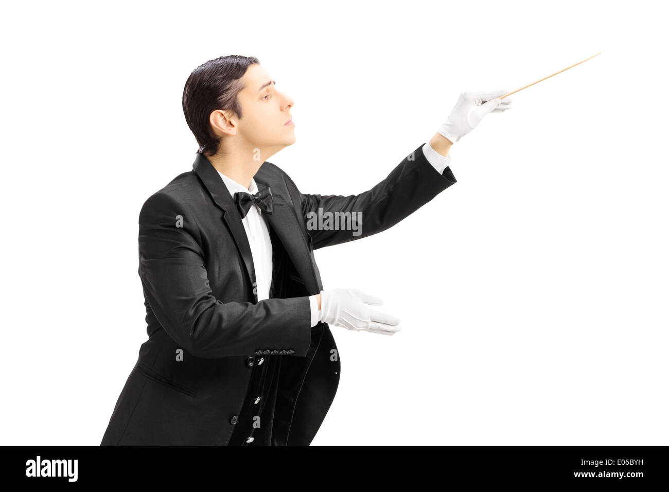 Male orchestra conductor directing with stick - Stock Image