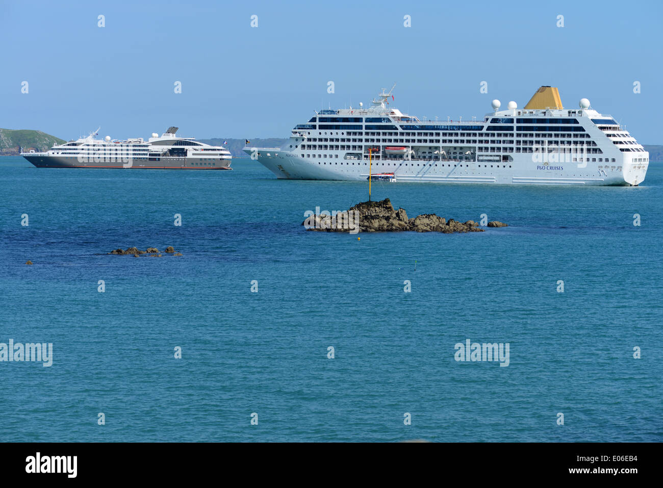 Cruise ships moored off the port of St. Peter Port, Guernsey, Channel Islands - Stock Image