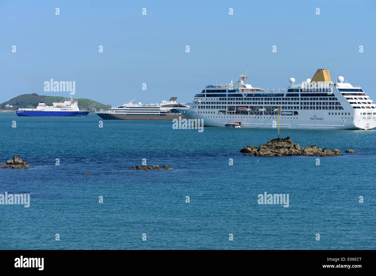 Cruise ships and a cross channel ferry off the coast of Guernsey, Channel Islands - Stock Image