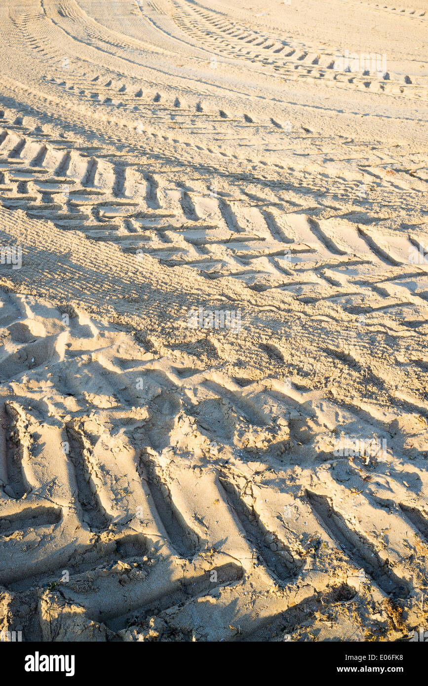 Full frame take of tyre tracks on sand - Stock Image