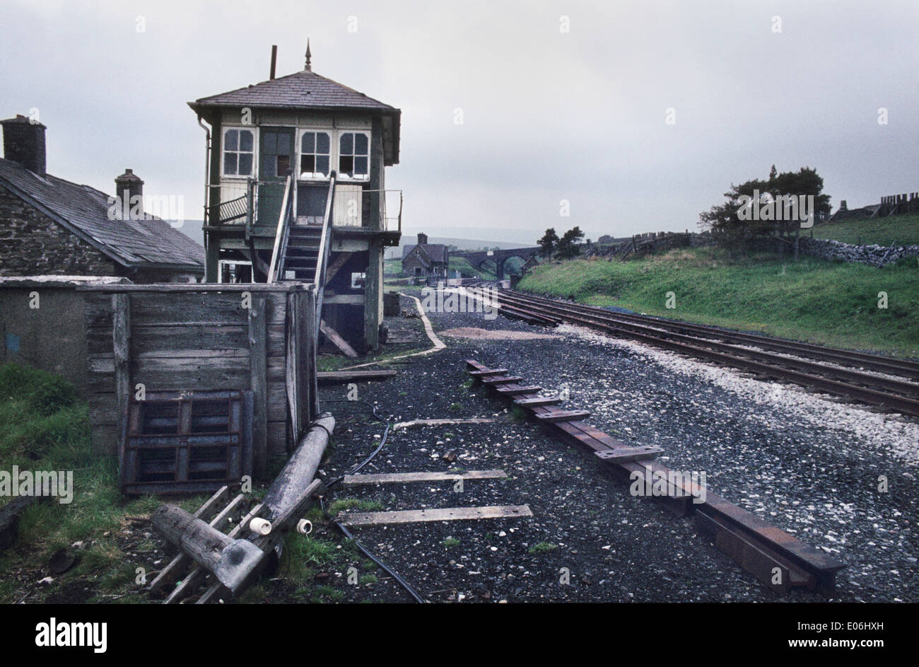 Dent railway station, on the Settle-Carlisle line, pictured in 1984, prior to the removal of signal box and renovation and conversion of buildings to holiday lets - Stock Image