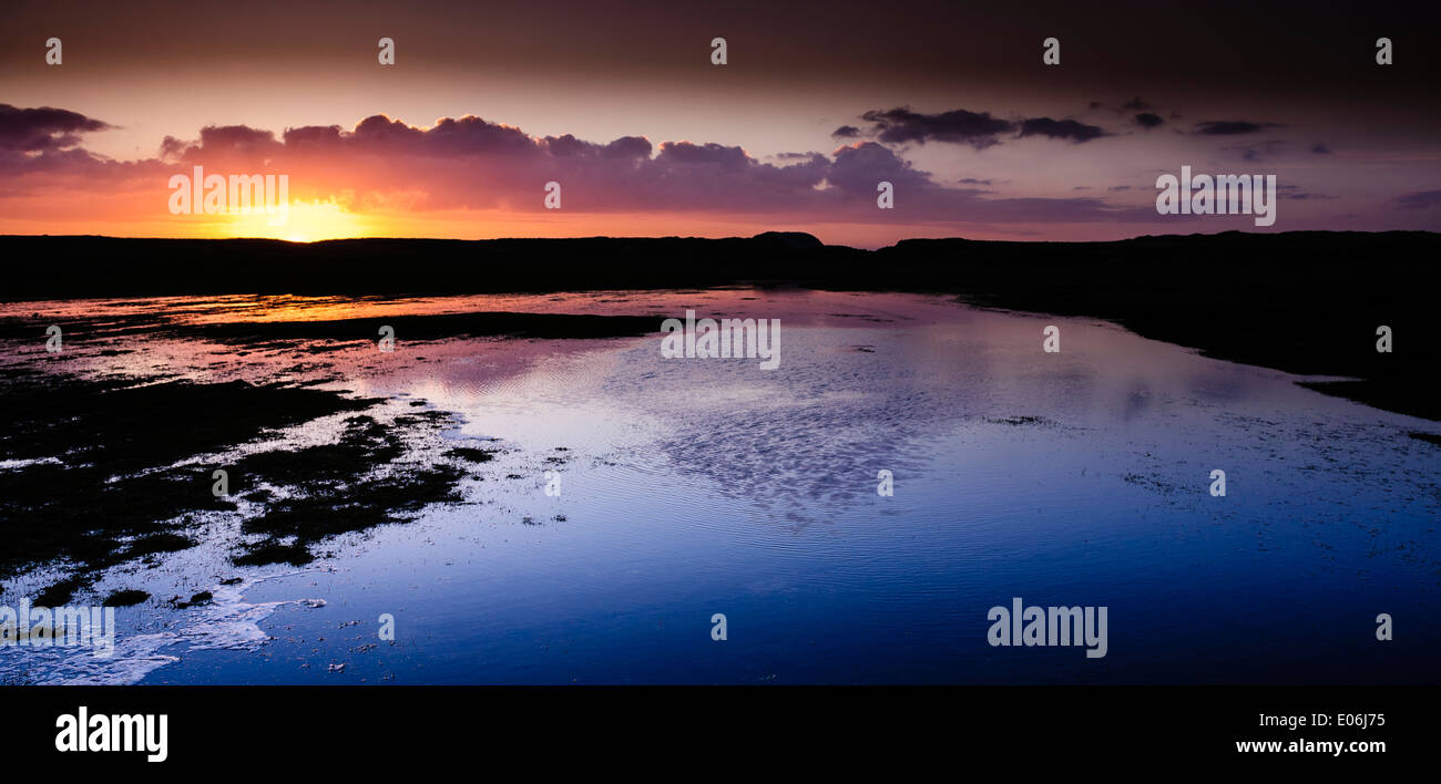 Sunset at Borve, Island of Berneray, Outer Hebrides, Scotland - looking towards the island of Boreray. - Stock Image