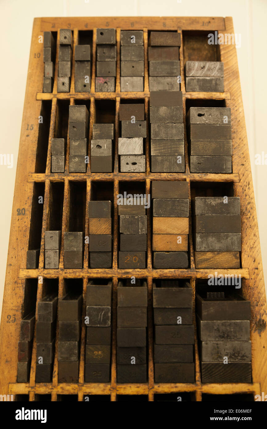 Vintage wooden and metal spacers in a  small letterpress print shop. - Stock Image
