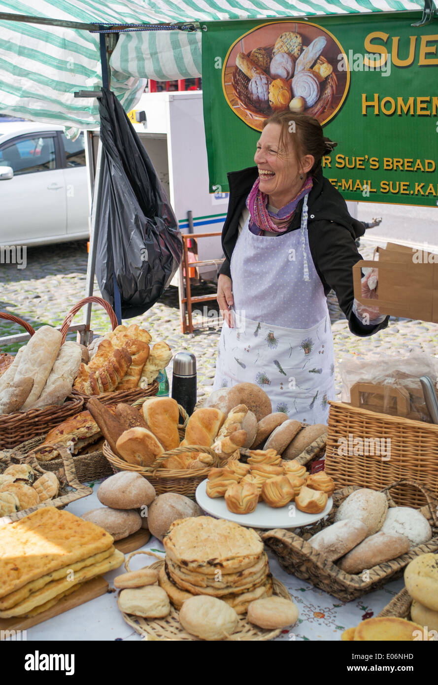 Sue's Bread, smiling lady artisan baker Barnard Castle farmers market north east England UK - Stock Image