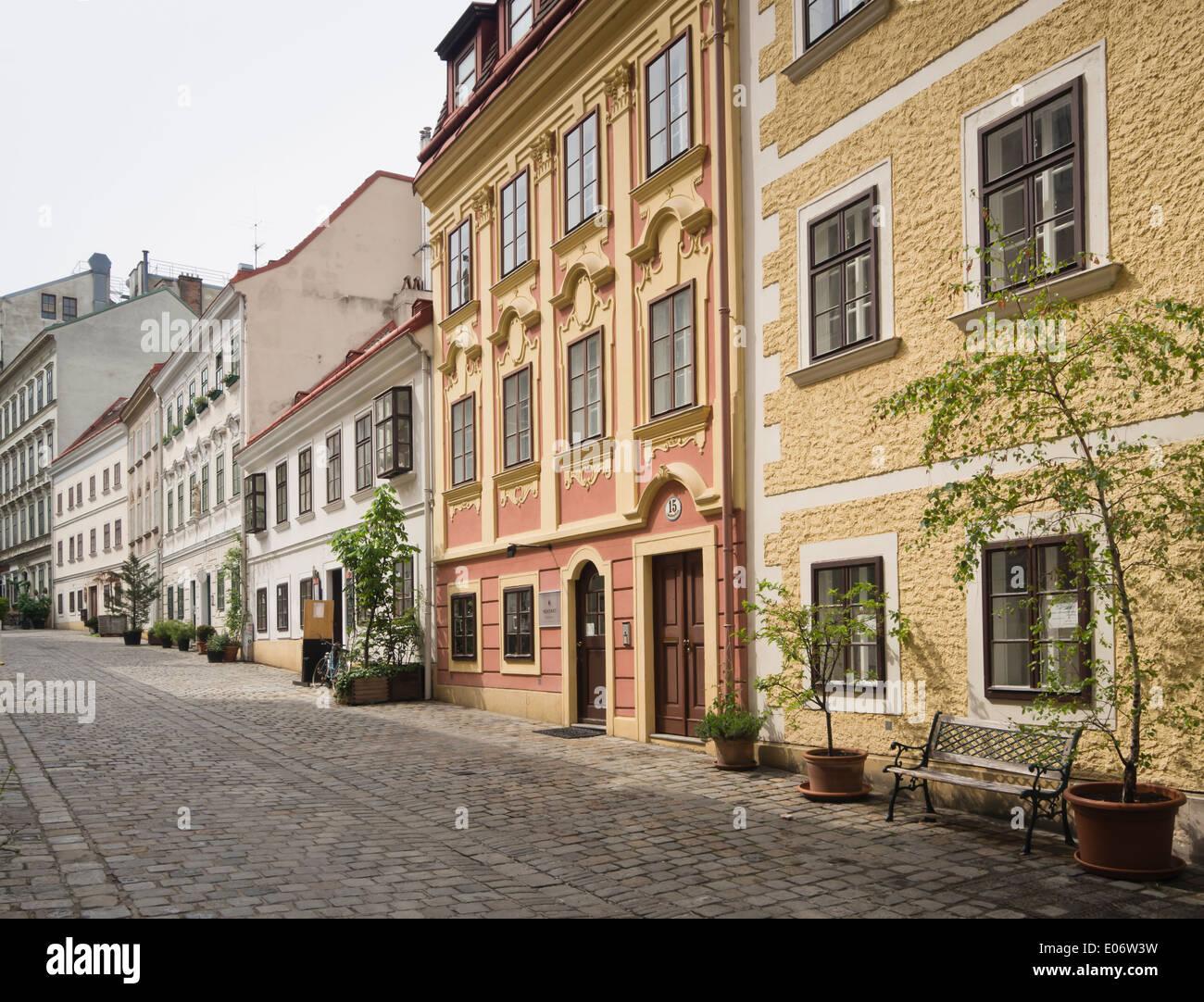 Narrow cobbled street with old house facades, Spittelberg Neubau ...