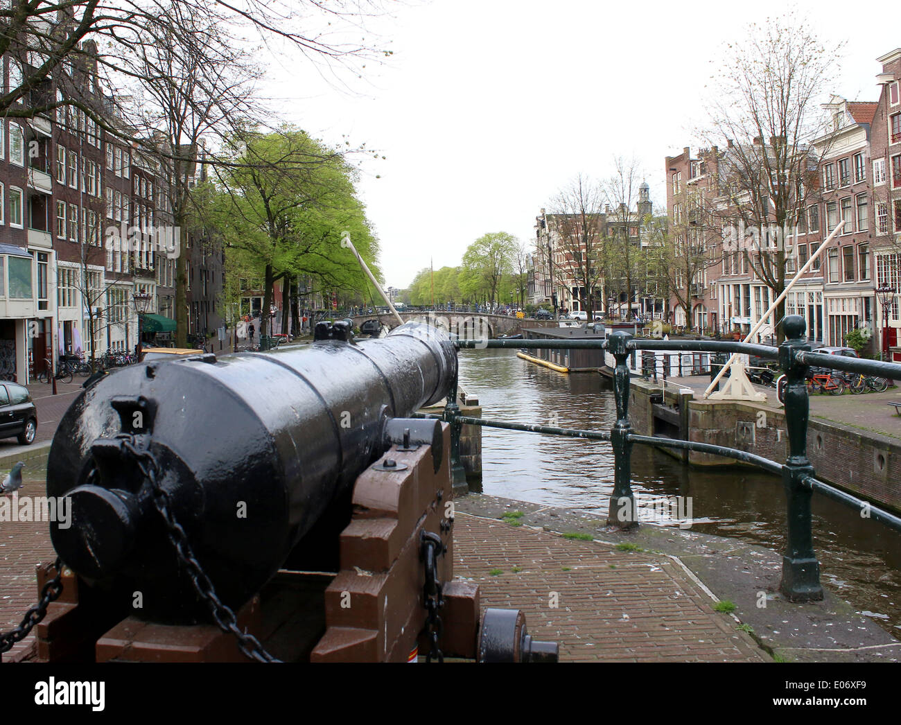 Old 19th century cannon at Prinsengracht canal in Amsterdam, The Netherlands - Stock Image