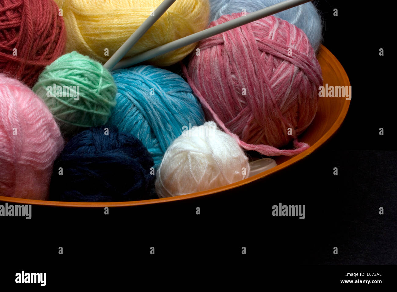 Multi-Colored Knitting Yarn in a Bowl - Stock Image