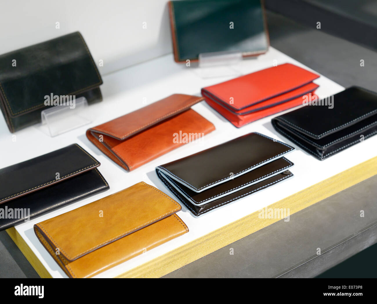 Mens folding leather wallets on display in a store - Stock Image