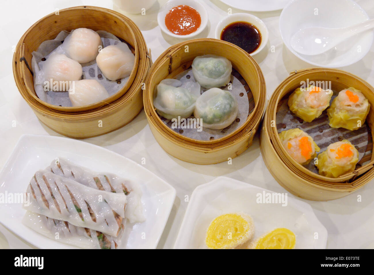 Dim sum dumplings dishes at a restaurant - Stock Image