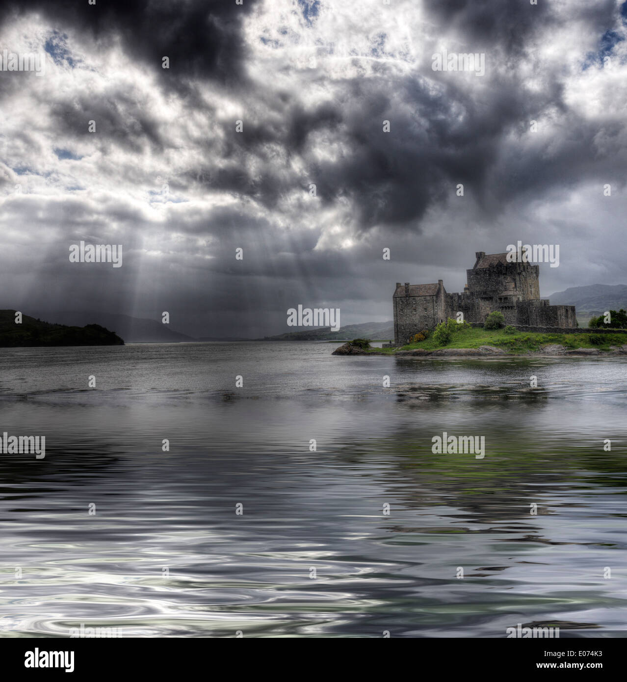 Dramatic lighting on Eilean Donan Castle in Scotland - Stock Image