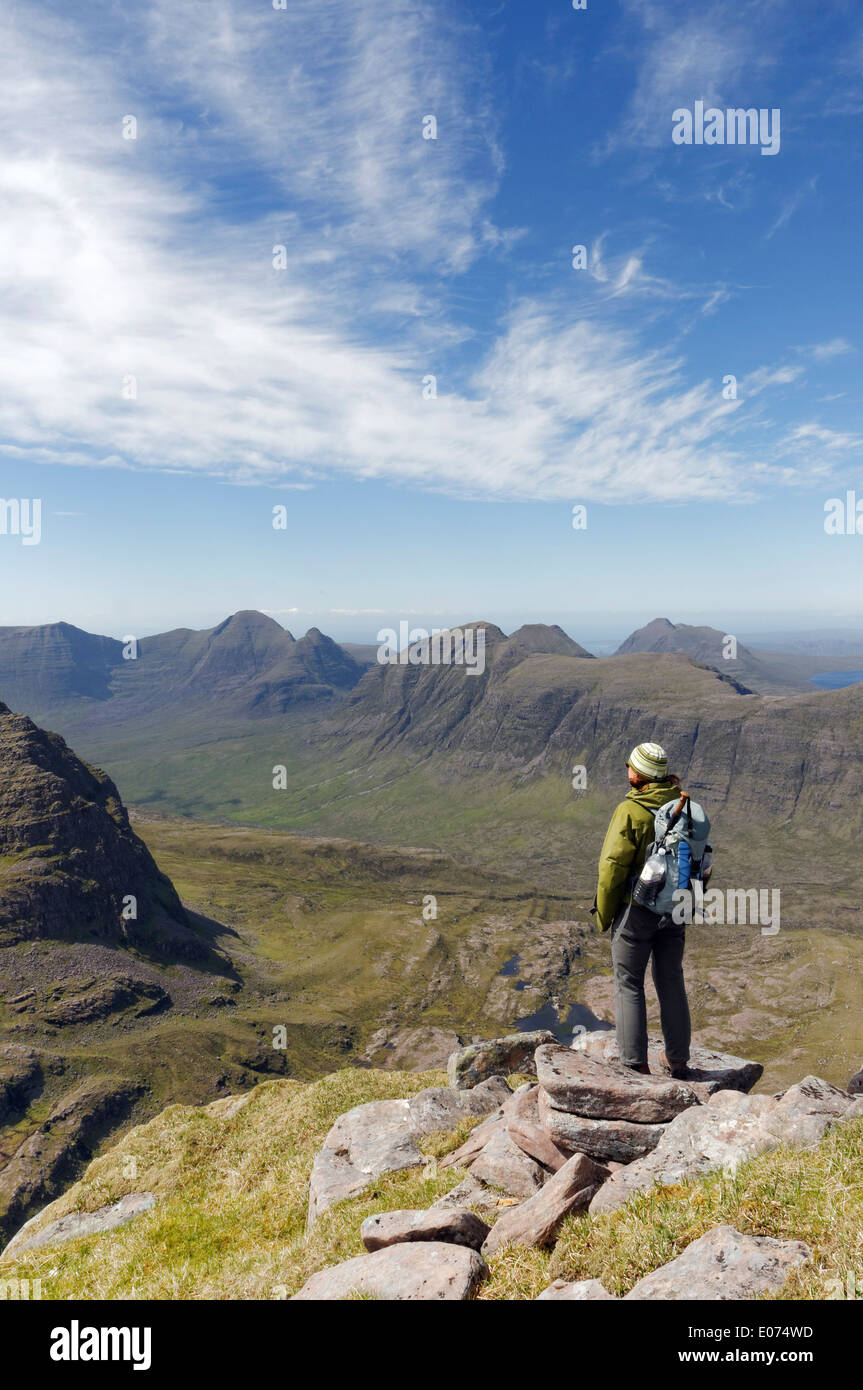 A lone hillwalker on the traverse of Liathac in the Torridon region of Scotland - Stock Image