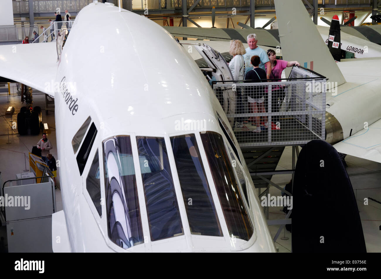 Visitors on Concorde at Duxford Air Museum - Stock Image