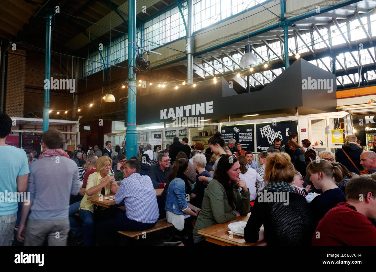Crowds inside Markthalle 9 in trendy Kreuzberg,Berlin - Stock Image