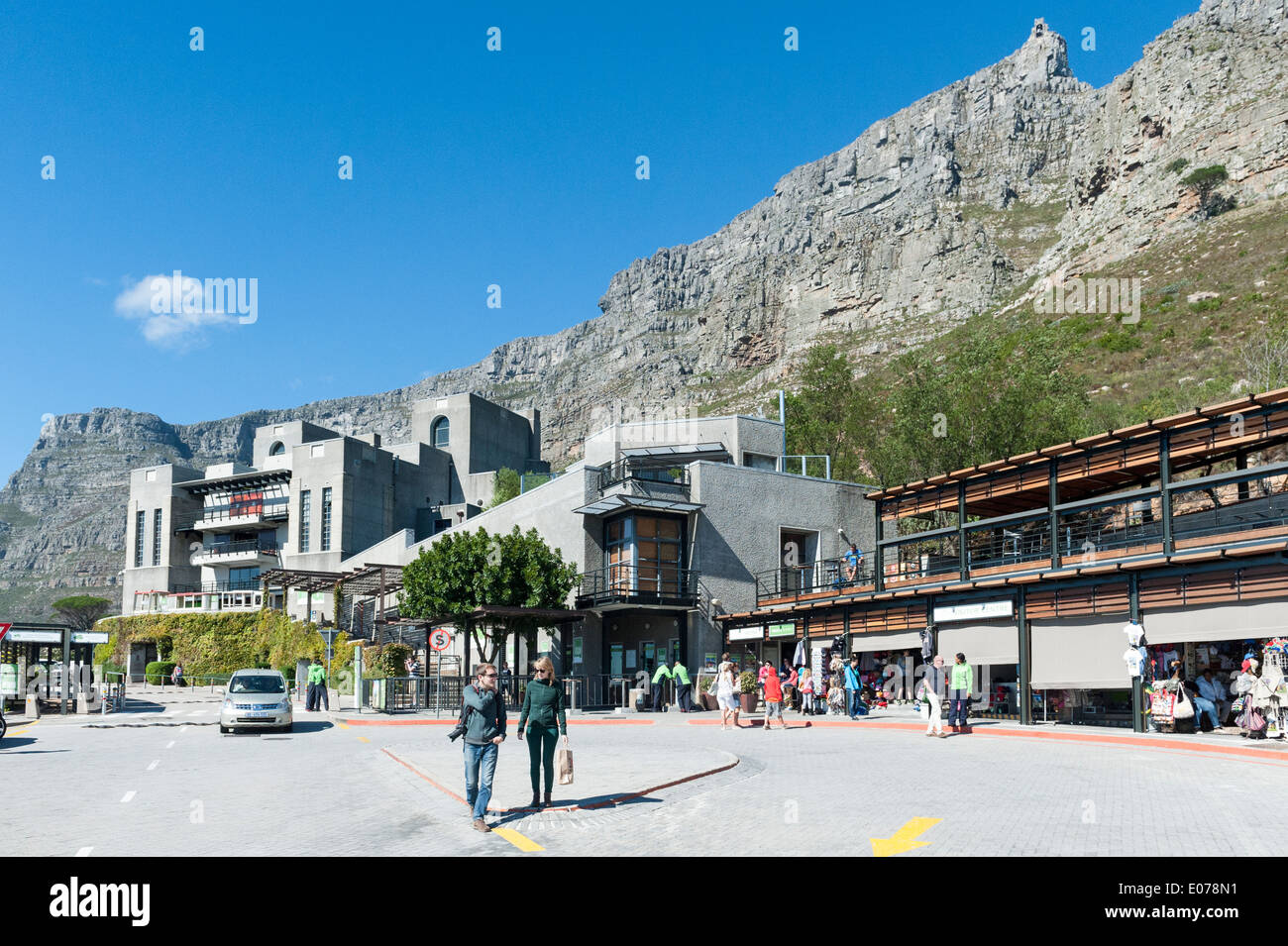 Tourists at cableway station with Table Mountain in the background, Cape Town, South Africa - Stock Image