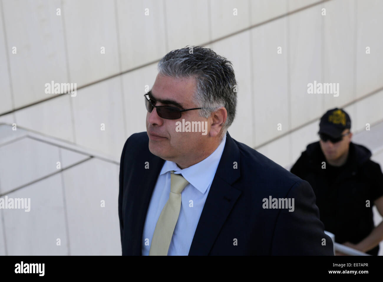 Athens, Greece. 5th May 2014. Golden Dawn's MP Nikos Kouzilos arrives at the Athens Supreme Cour. Golden Dawn MPs were invited by the Special Appellate magistrate, to account for the category of membership and directing a criminal organization. Athens, Greece on May 5, 2014. Credit:  Konstantinos Tsakalidis/Alamy Live News - Stock Image