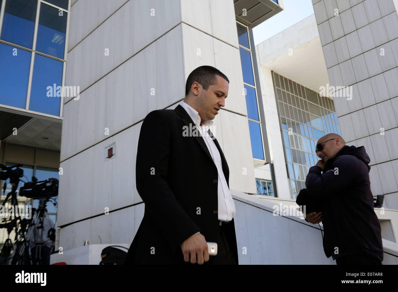 Athens, Greece. 5th May 2014. Golden Dawn's MP Ilias Kasidiaris departs from the Athens Supreme Court. Golden Dawn MPs were invited by the Special Appellate magistrate, to account for the category of membership and directing a criminal organization. Athens, Greece on May 5, 2014. Credit:  Konstantinos Tsakalidis/Alamy Live News - Stock Image